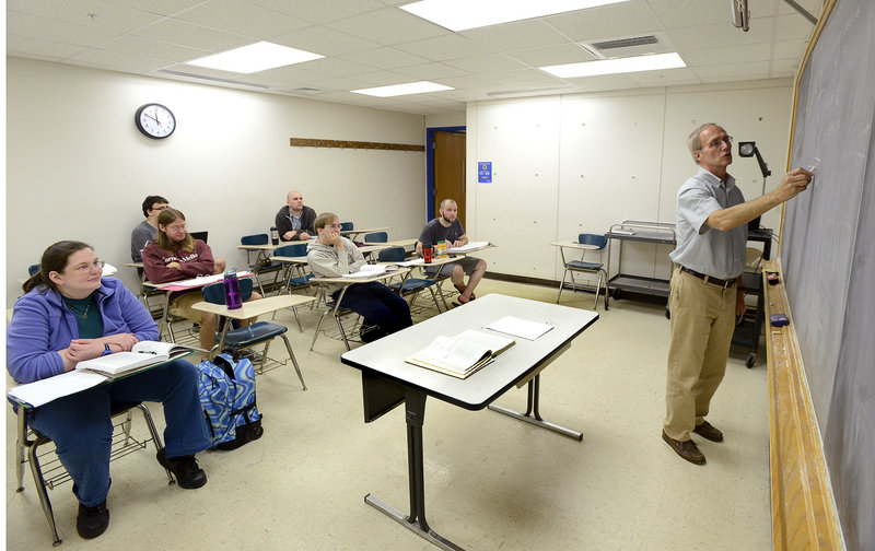 Bob Coakley teaches a physics class at the University of Southern Maine campus in Portland last week. The move to cut physics has rankled faculty, students and members of the community, who have written letters in support of keeping the program.