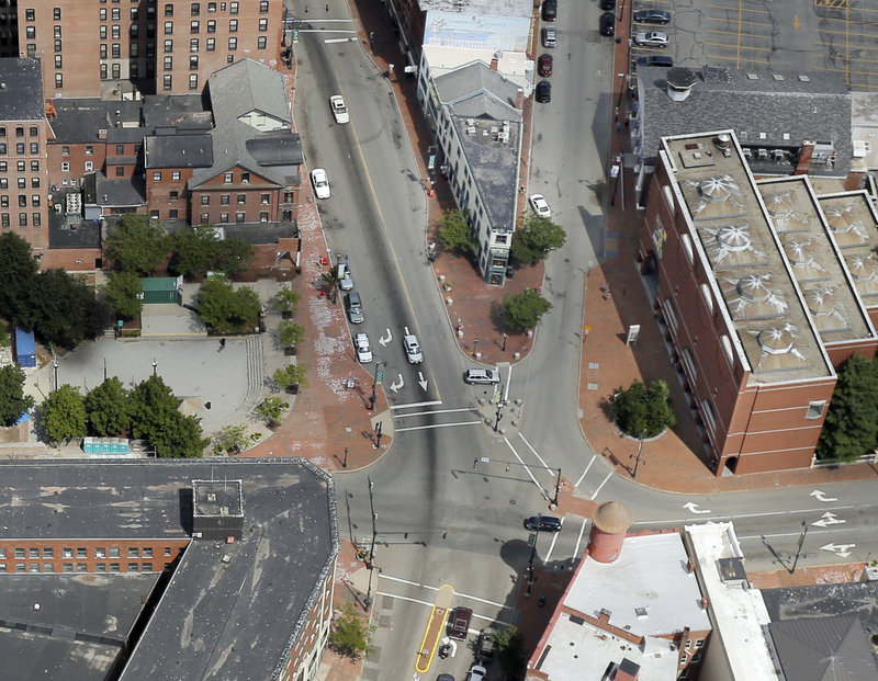 Portland's City Council voted Monday to sell part of Congress Square Plaza, left, as well as consider a redesign of the intersection of Congress and High streets.