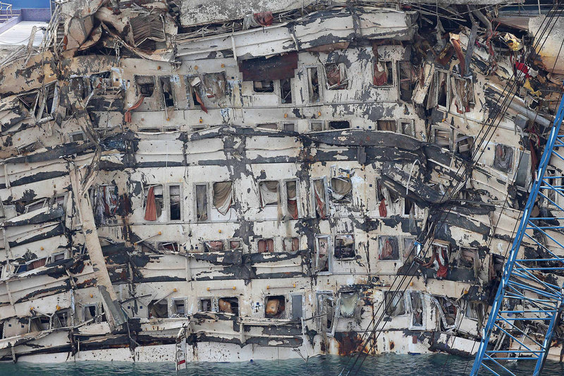The deformed side of the Costa Concordia is seen after it was lifted upright off the island of Giglio, Italy, Tuesday. The crippled ship was pulled completely upright by counterweights.