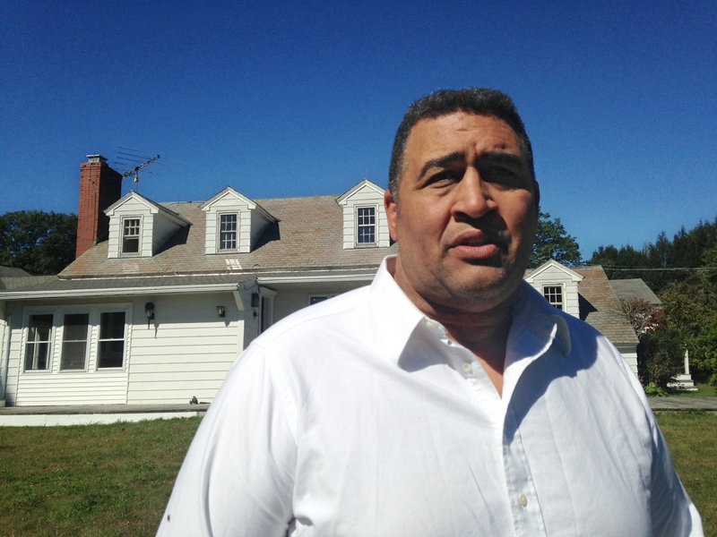 Brian Holloway stands in front of his home Wednesday in Stephentown, N.Y.