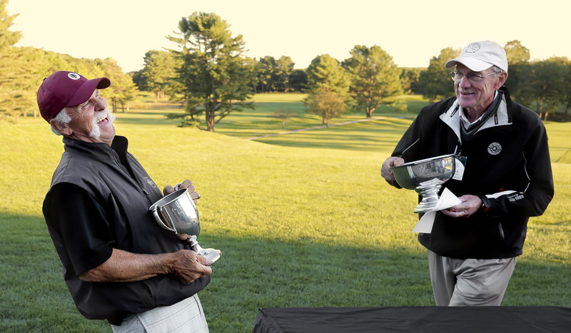 Shawn McLoughlin, left, has a good laugh – and another New England Senior Amateur golf championship – as he accepts the trophy at Portland Country Club on Wednesday.