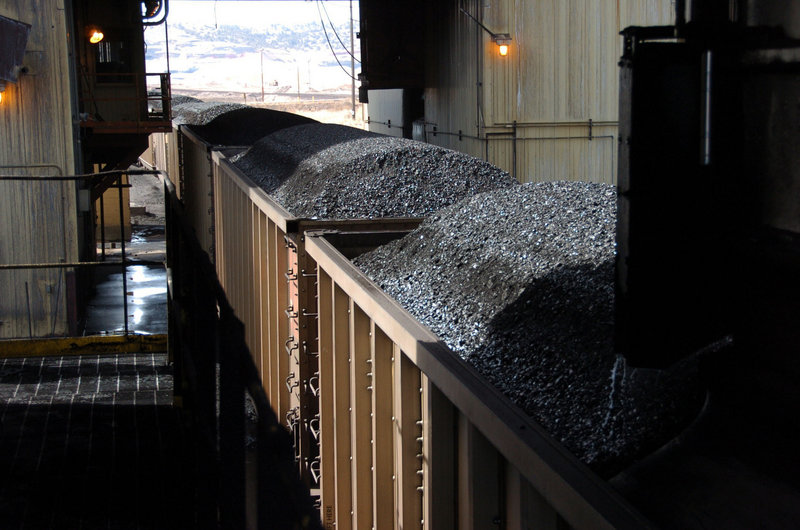 Coal passes through a loading terminal earlier this year at the Spring Creek mine near Decker, Mont. U.S. coal production is on track to fall to a 20-year low in 2013.