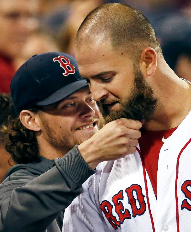 Beard-pulling is a new tradition in Boston, as Mike Napoli gets his pulled by Clay Buchholz after Napoli's homer on Wednesday.
