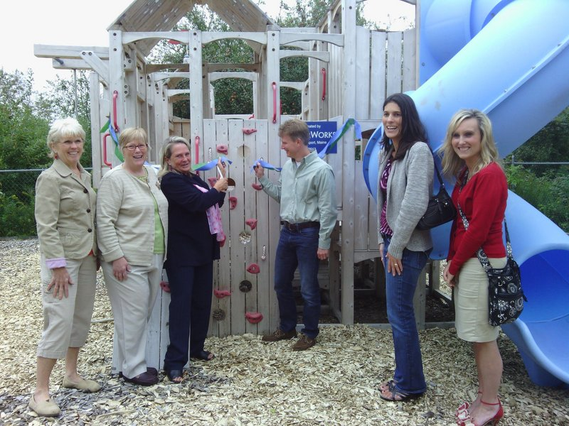 Broadreach Family & Community Services and CedarWorks staffers pose during the dedication of playground equipment that CedarWorks donated recently. From left are Helen Kosmo, Broadreach board member; Mary Bailey, Broadreach director; Kate Quinn Finlay, Broadreach executive director;  Barrett Brown, CedarWorks owner and president; Teri Kenniston, CedarWorks customer service manager;  and Allison Heidorn, CedarWorks marketing coordinator.