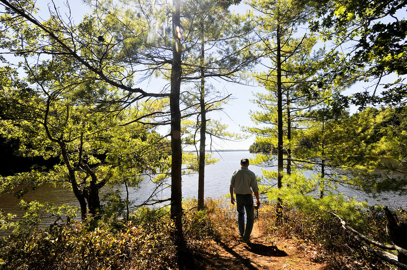 The path to a scenic overlook on the Back River in Wiscasset is an ideal example of the offerings of the Great Maine Outdoor Weekend. Henry Heyburn, assistant director of the Chewonki Camp for Boys, soaks in the view.