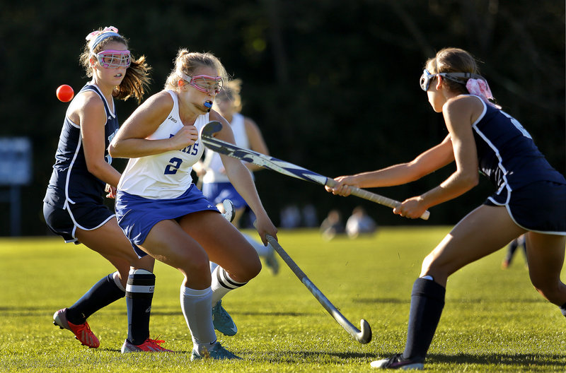 York's Sarah Panteleos fires the ball past Kennebunk's Meg Cadigan during the Wildcats' 5-0 win Thursday.