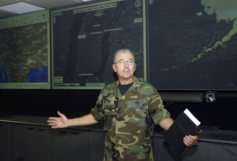 An officer at a Colorado fusion center, whose identity was withheld, gives the media a tour of the facility in 2004. Fusion centers were established to collect information on suspicious people and generate terrorism leads.