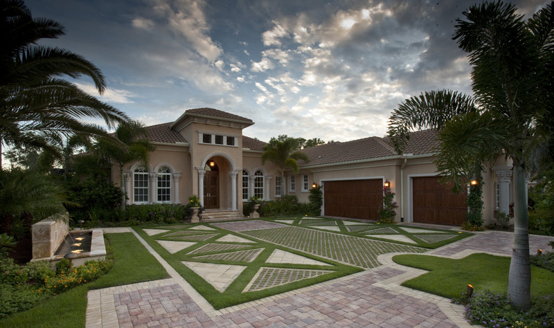 In a living driveway in Naples, Fla., grass is interspersed among pavers, which reduces heat and glare and provides drainage. It was designed by landscape architect W. Christian Busk.