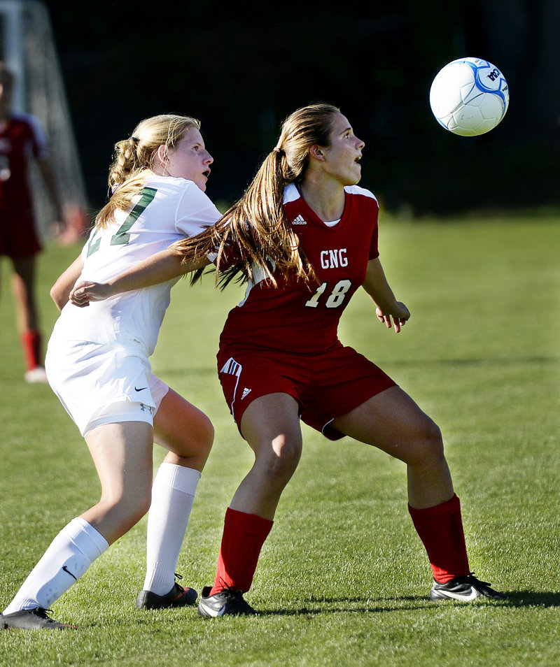 Maria Valente of Gray-New Gloucester tries to shield Waynflete's Marijke Rowse away from the ball during their Western Maine Conference girls' soccer game Friday in Portland. Waynflete won, 3-0.