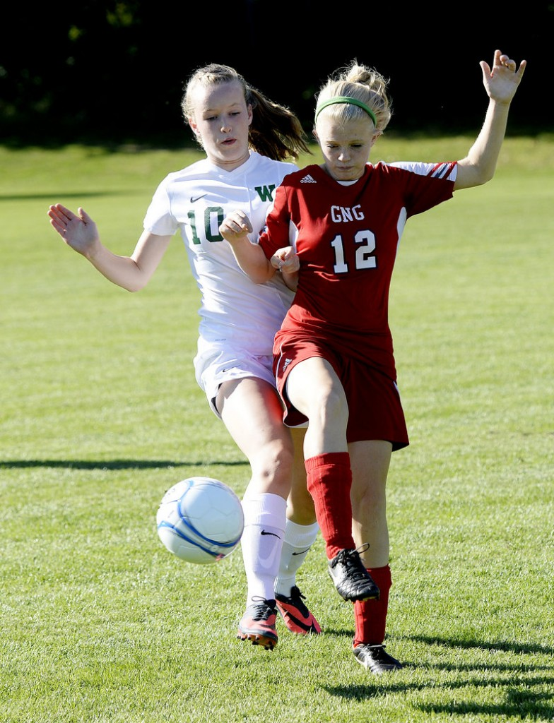 Arianna Giguere, left, of Waynflete fights for possession with Emily Hotham of Gray-New Gloucester.