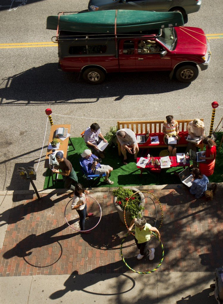 Employees and friends of The Via Agency on Congress Street participate in Portland's second annual Park(ing) Day on Friday, Sept. 20, 2013. Taking place in nearly 200 cities around the world, people take over parking spaces for to hang out and have fun.