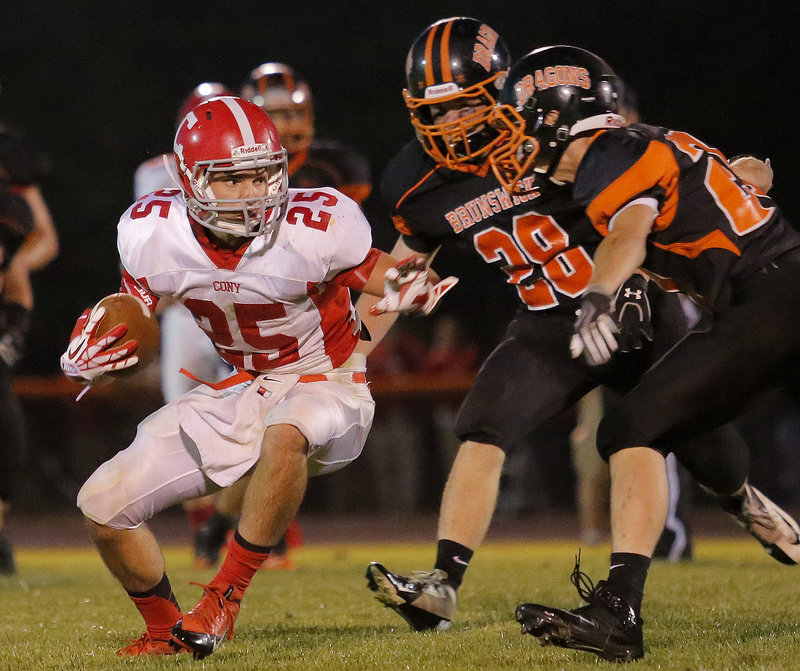 Tayler Carrier of Cony makes eye contact with Brunswick defender Bailey Caparratto, right, before making physical contact.
