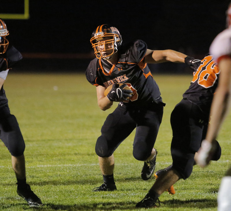 Brunswick running back Alex Bandouveres finds room to rush for a touchdown against Cony on Friday night, one of many touchdowns scored by both teams in the Dragons' 54-38 win over the Rams.