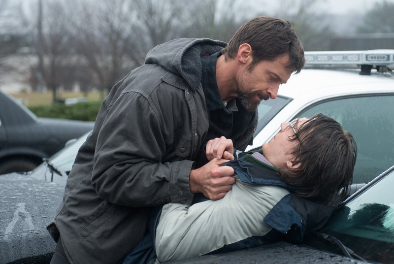 "Hugh Jackman, left, confronts Paul Dano in a scene from ""Prisoners."""