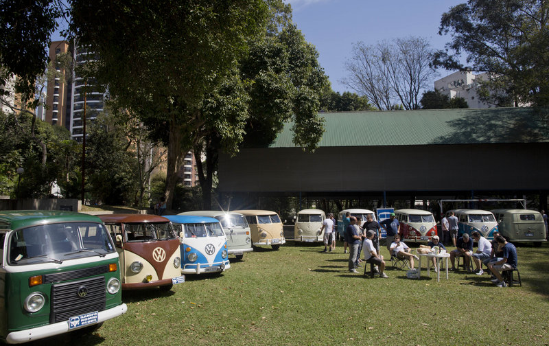 "Members of the Sampa Kombi club, a group of Volkswagen van owners, gather for their monthly meeting in Sao Paulo. In Brazil, the VW van is known as the ""Kombi."""