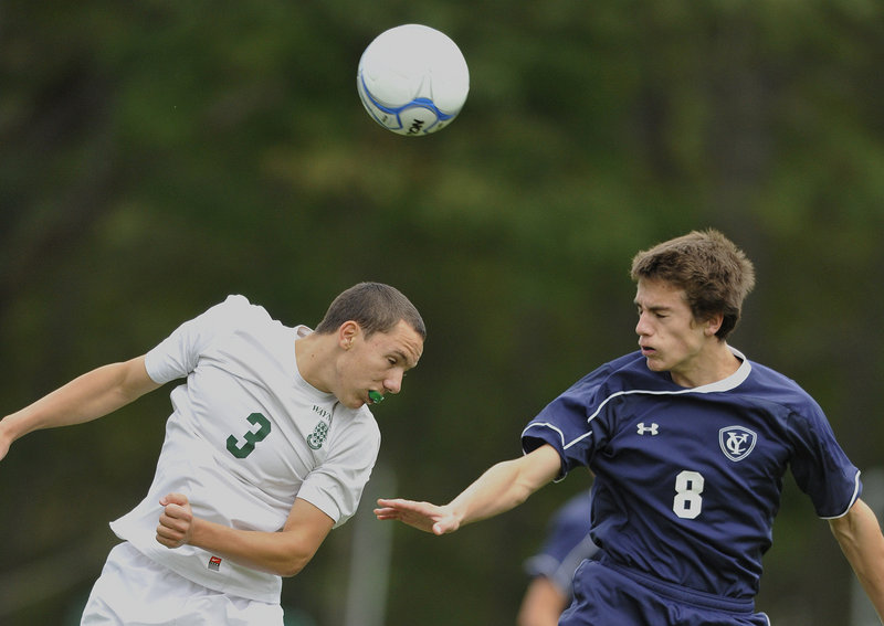 Harry Baker-Connick of Waynflete, left, heads the ball past Walter Conrad of Yarmouth during Yarmouth's 3-0 victory Tuesday at the Fore River Complex.