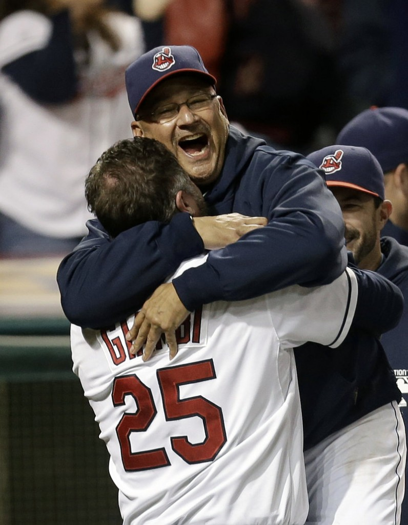 Indians Manager Terry Francona hugs Jason Giambi, who hit a two-run pinch-hit homer in the bottom of the ninth inning Tuesday to give Cleveland a dramatic 5-4 win over the Chicago White Sox.