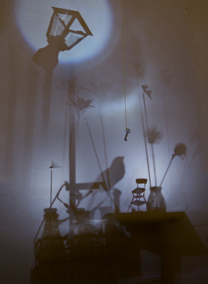 """""""The Passenger"""" by Marguerite White, cut paper, vellum, turntables, halogen lights and sound, courtesy of the artist and John Swisher."""