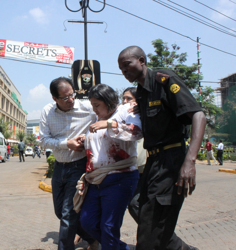 "A security officer helps a wounded woman Saturday outside a mall in Nairobi, Kenya, during an attack that left dozens of people dead. A reader criticizes the ""overhyping"" of allegations that a Somali-American Mainer was involved in the raid."