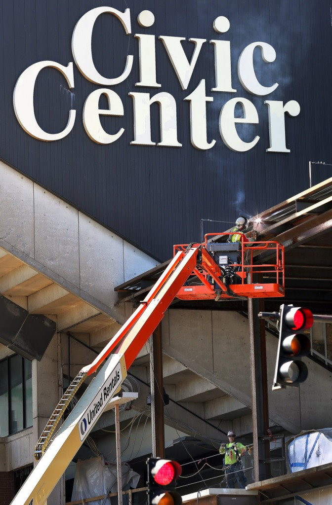 A welder works on the exterior of the Cumberland County Civic Center on Friday. The Portland Pirates' departure leaves the civic center without an anchor tenant.