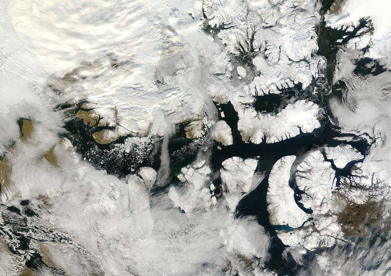 An ice-free Northwest Passage is seen in this September 2007 satellite photo from NASA. Interest in the passage is heating up as the ice that once made it impenetrable melts. An expert calls the rapid advance of global warming unsettling, even as he notes that it is opening up a new frontier.