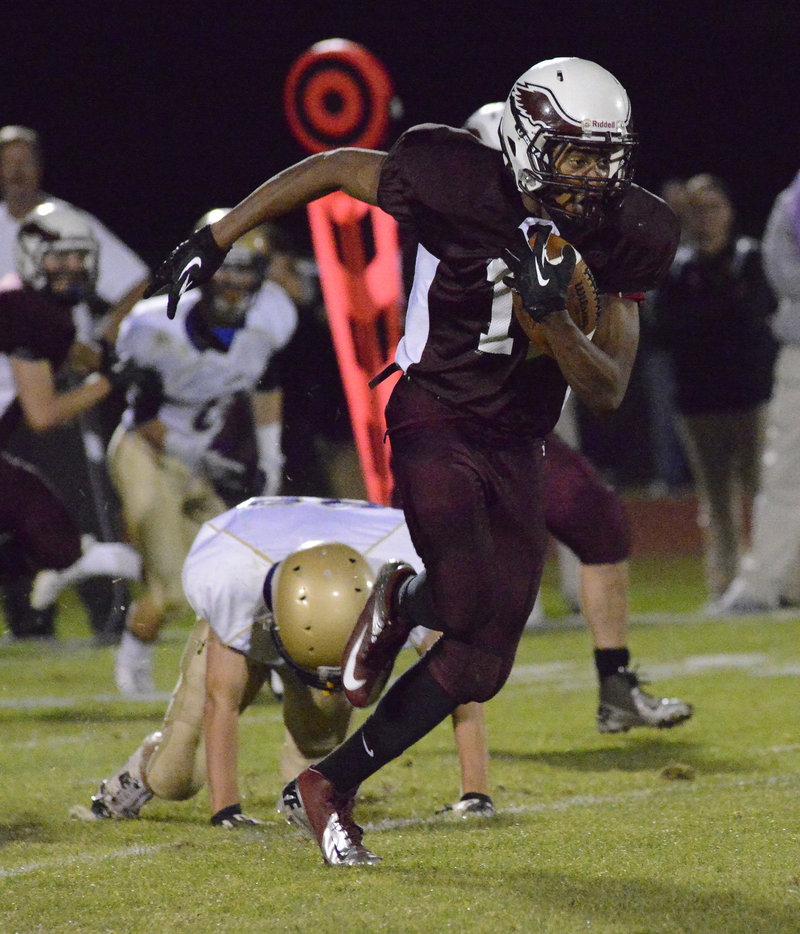 Eric Webb of Windham slips away from Kenny Drelich of Cheverus and goes on to score a touchdown on a 78-yard pass play in the first quarter.