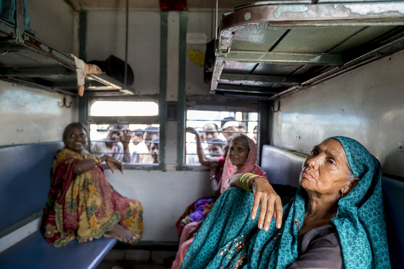 Sondi (no last name given, at right) rides with friends in a women-only train car in New Delhi, India. After a brutal gang rape spotlighted violence against women, many crave safety.
