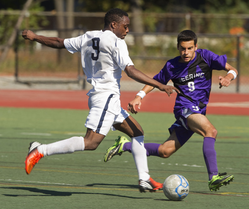 Yusef Yama of Portland brings the ball up the field Saturday as Ahmed Adnan of Deering applies pressure during their SMAA boys' soccer game at Fitzpatrick Stadium. Both teams are 6-1-1 after Portland's 2-0 victory.