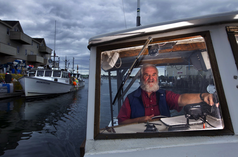 Casco Bay keeper Joe Payne pilots his boat off Portland. He received a new 28-foot boat this month in honor of his 22 years of work protecting the bay.