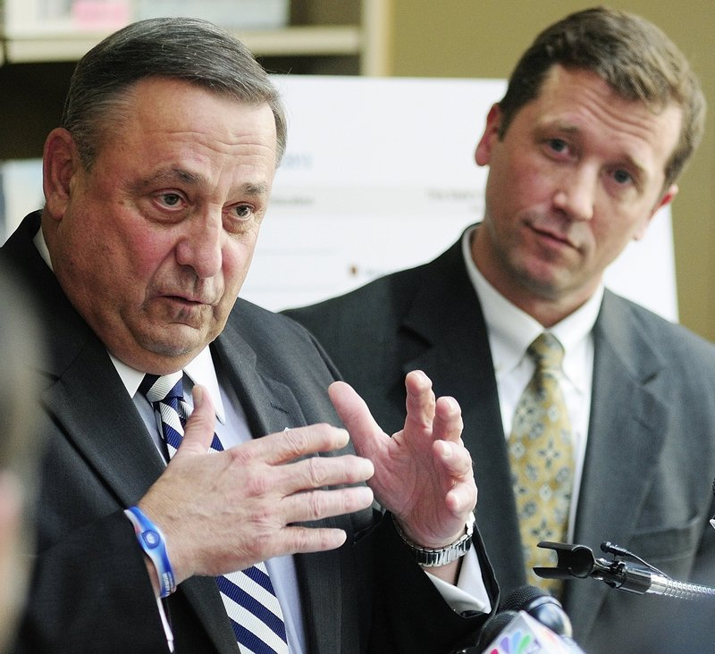 Then-Education Commissioner Stephen Bowen listens in May as he and Gov. Paul LePage unveil the state's new A-F grading system for schools at the Maine State Library.