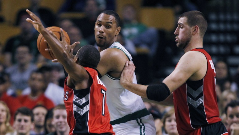 In this file photo, Boston Celtics power forward Jared Sullinger, center, looks to pass against the Toronto Raptors during a preseason NBA basketball game, Monday, Oct. 7, 2013. A judge on Monday, Oct. 28 dismissed domestic violence charges against Boston Celtics forward Jared Sullinger after his girlfriend said she would refuse to testify against him.