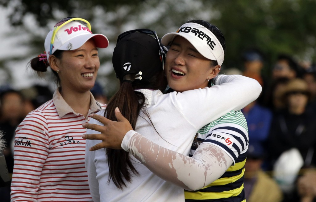 Amy Yang of South Korea, right, is congratulated by Danielle Kang of the United States, center, and Chella Choi of South Korea after winning the KEB Hana Bank Championship golf tournament at Sky72 Golf Club in Incheon, west of Seoul, South Korea on Sunday.