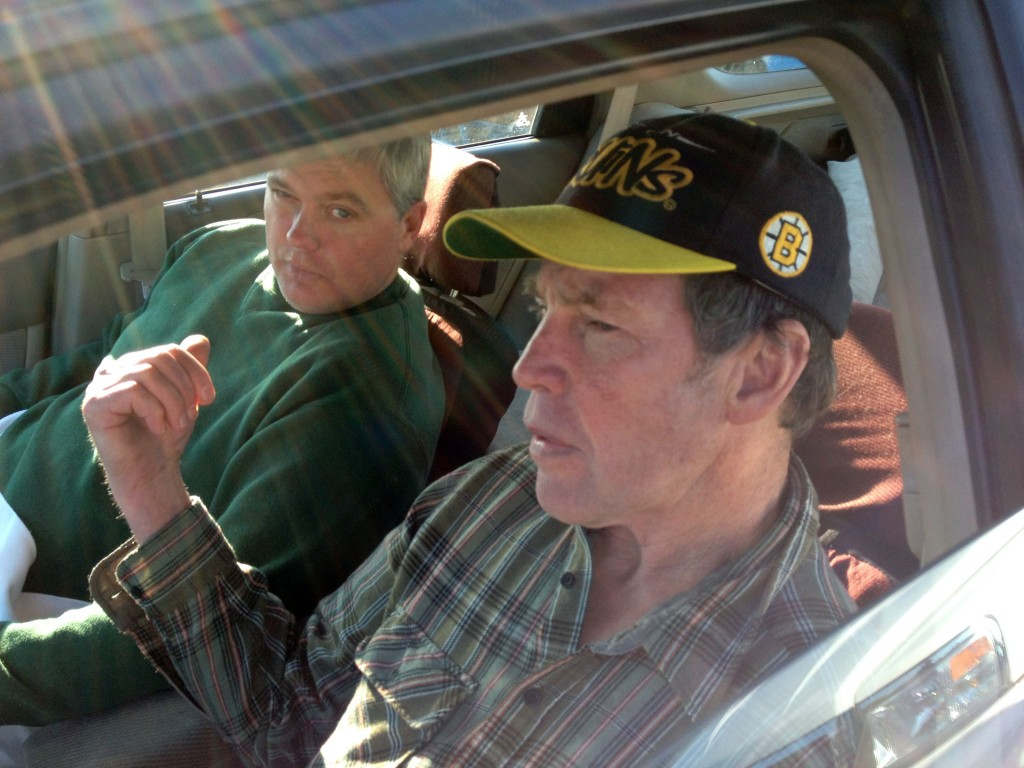 Fred Schaeffer, left, of Raymond, N.H., and George Reynolds, right, of Derry, N.H. sit in a car after being rescued in waters off of Salem, Mass. The two New Hampshire men whose boat capsized off the Massachusetts coast prayed and sang gospel songs as they survived a 15-hour ordeal that ended with them being rescued by a passing fishing boat. The men spent Friday night sitting on a plank over two hulls of a 25-foot trimaran as waves crashed over them through the night.