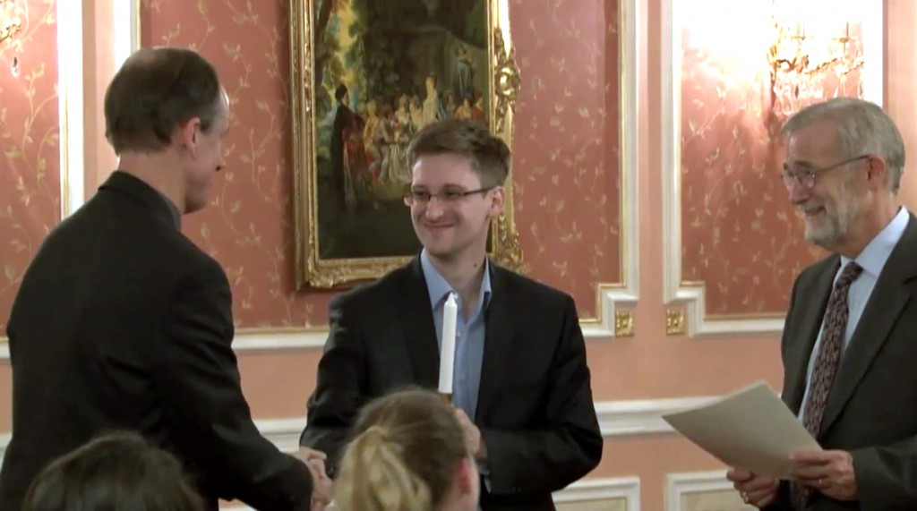 In this image made from video released by WikiLeaks on Oct. 11, 2013, former National Security Agency systems analyst Edward Snowden, center, receives the Sam Adams Award in Moscow, Russia. AP Photo