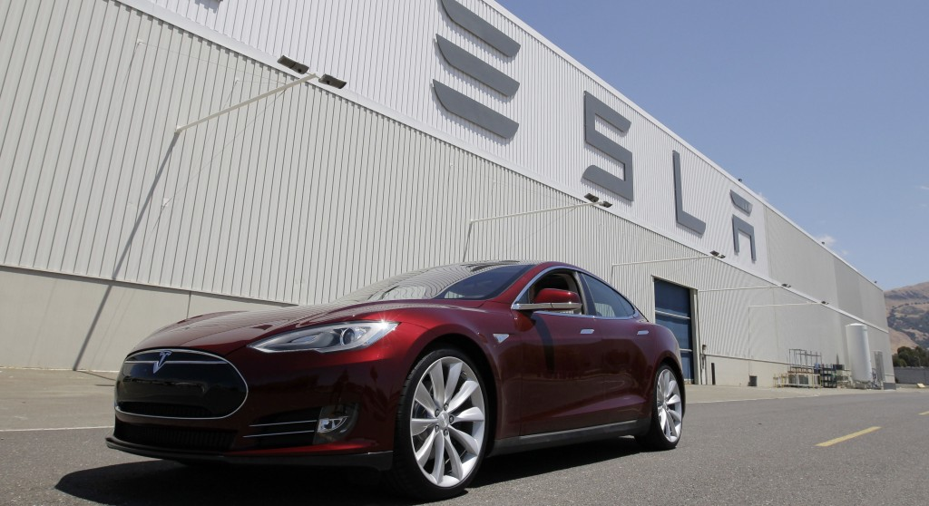 A Tesla Model S sits outside the Tesla factory in Fremont, Calif. Shares of Tesla Motors are down as investors in the high-flying company assess the fallout from a fire in one of its $70,000 electric cars.