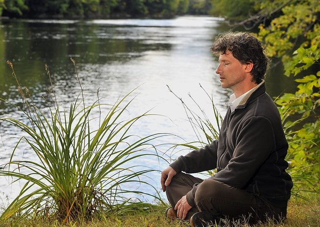 Kevin Emmons of Hollis, a druid, meditates. Modern druids believe in the divinity of nature.