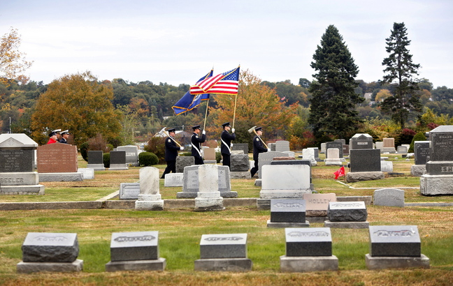 The Portland Fire Department Honor Guard leads members of the Portland and South Portland fire departments in a procession during the annual Memorial Sunday Service to honor fallen firefighters at Forest City Cemetery in South Portland on Sunday.