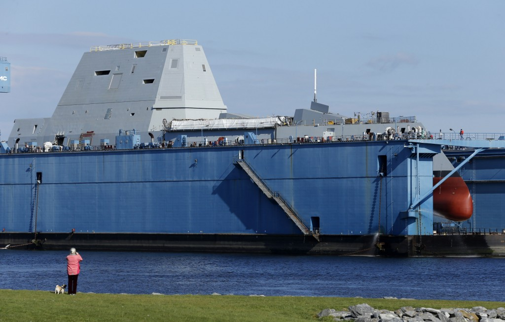 The first-in-class Zumwalt, the largest U.S. Navy destroyer ever built, is seen in dry dock Monday in Bath. The ship features an unusual wave-piercing hull, electric drive propulsion, advanced sonar and guided missiles, and a new gun that fires rocket-propelled warheads as far as 100 miles.