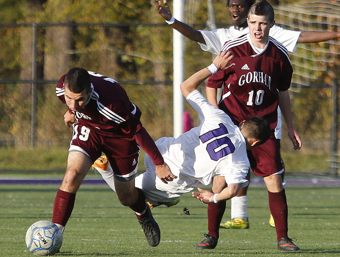 Matt Hooker of Gorham left, collides with Frankie Alvarez of Deering during the first half of their Western Class A boys' soccer quarterfinal Wednesday. Gorham used a second-half goal to come away with a 1-0 victory on the road.