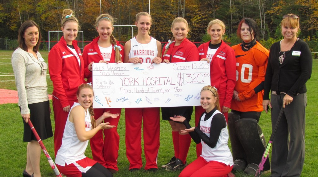 Members of the Wells High School field hockey team recently presented a check in the amount of $320 to Dr. Amanda Demetri Lewis, D.O., of York Hospital, left. With her, standing from left, are players Jasmine Loukola, Gabi Betters, Liz Bouchard, Randi Albano, Kayla Albano, Paige Barbour and hospital worker Joann Paquette. Sitting are Christina LeBlanc and Kassie Batchelder.