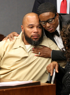 Gerard Richardson is hugged by his sister, Yvette Green, after a hearing in Somerville, N.J., Monday, where a judge overturned his murder conviction and ordered him released.