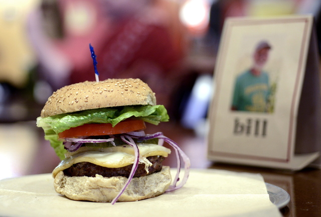The Cousin Oliver burger features lettuce, tomato, onion and Chef Tony's homemade pickles.
