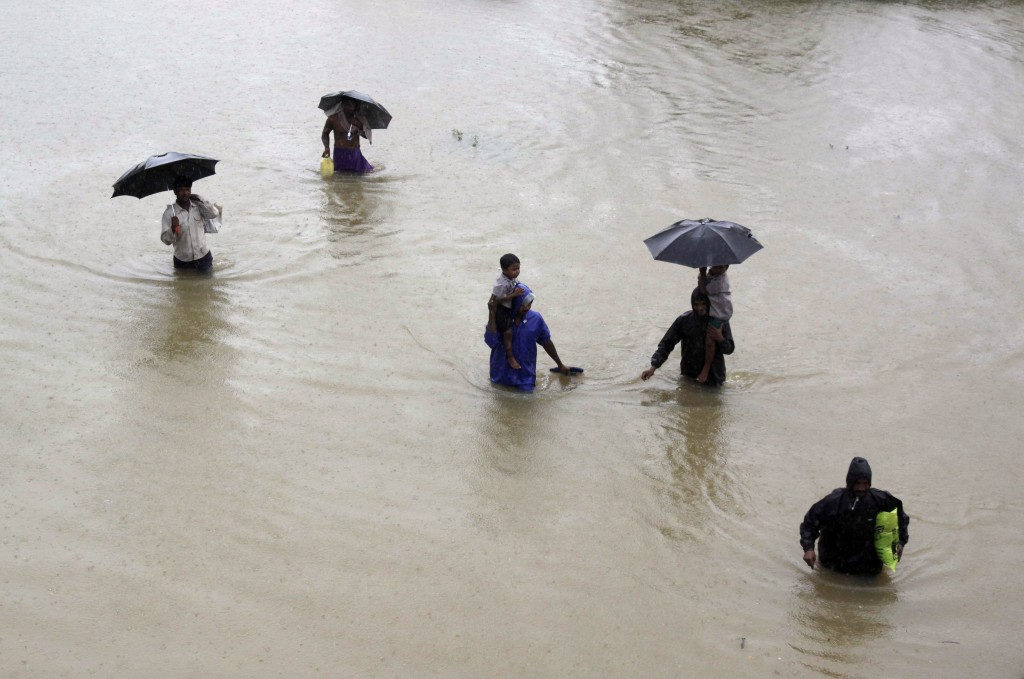 Villagers wade through floodwaters to reach safer areas in Khurda district in the eastern Indian state of Orissa on Friday. More than 70,000 people have been evacuated.