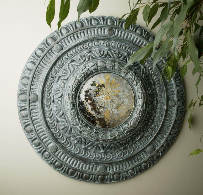 A faux medallion adds a decorative touch.