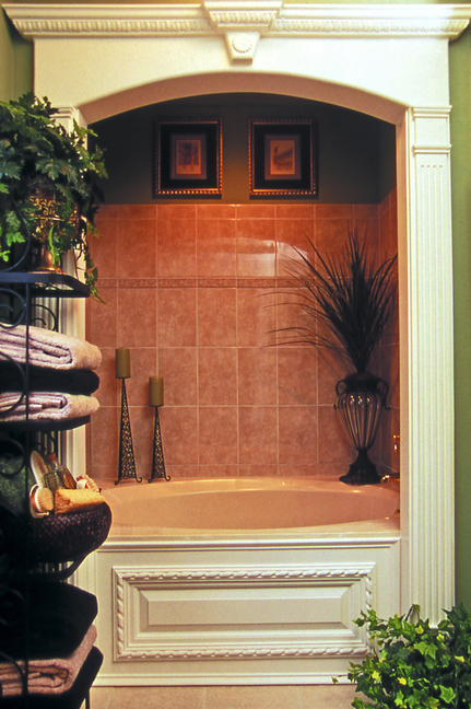"""Phoebe Taylor added this architectural detail to enhance her master bathroom. Taylor's 20-year-old suburban Atlanta house began plain and """"builder grade."""""""