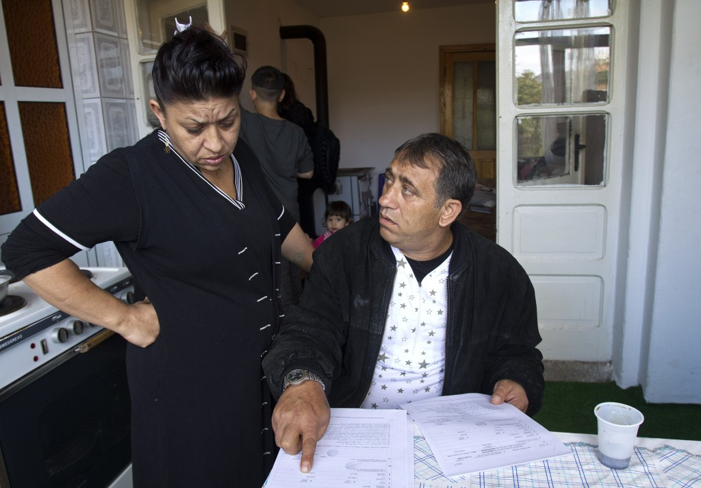 Resat and his wife Dzemila Dibrani look at a copy of the Italian birth certificate of daughter Leonarda Dibrani in a shelter house in the northern town of Mitrovica, Kosovo, Friday Oct. 18, 2013. The family were expelled from France as illegal immigrants last week and Leonarda Dibrani, taken by police from a school field trip last week, shocked many. Thousands of high school students protested in Paris angry at the expulsion of immigrant children and families like the Dibrani family. The demonstration came as the government was finalising a report on Friday into the treatment of a 15-year-old girl taken by police from a school field trip, then deported to Kosovo with her family as illegal immigrants.