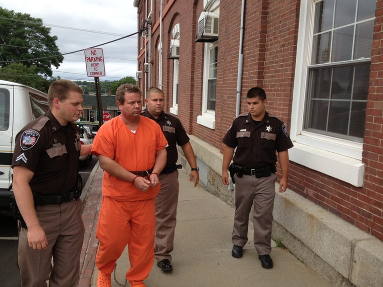 Sheriff's deputies lead Todd Gilday into Waldo County Superior Court in Belfast on Aug. 29. Gilday was indicted Thursday on a murder charge in the shooting death of Lynn Arsenault in Belfast.