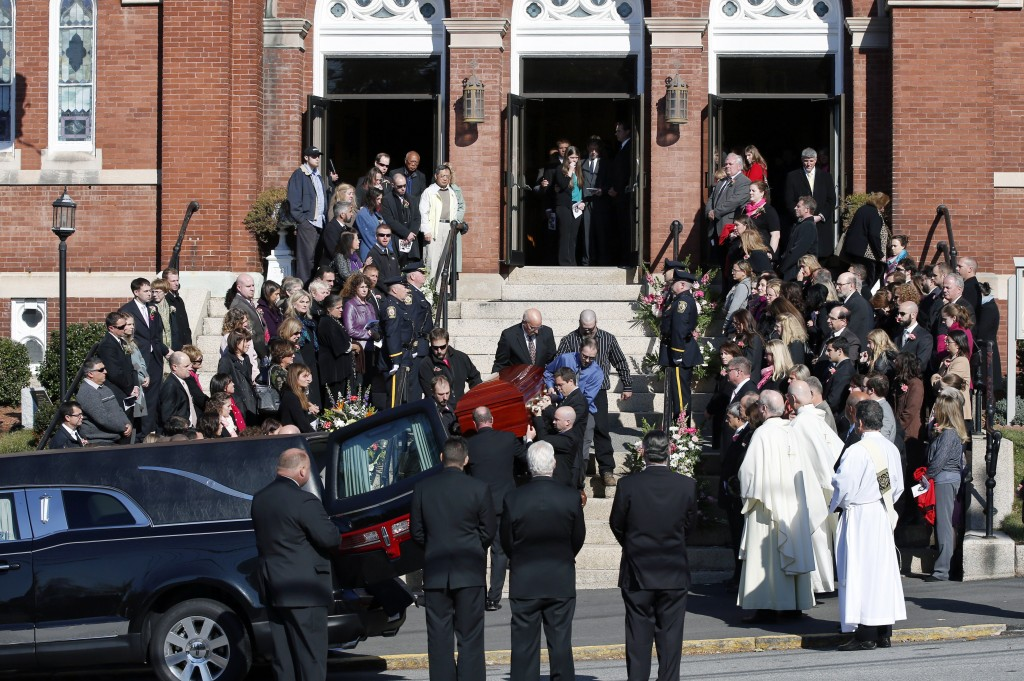 Mourners line the steps of St. Augustine Church in Andover, Mass., Monday as the casket of slain Danvers High School teacher Colleen Ritzer is carried out from her funeral Mass into a hearse.