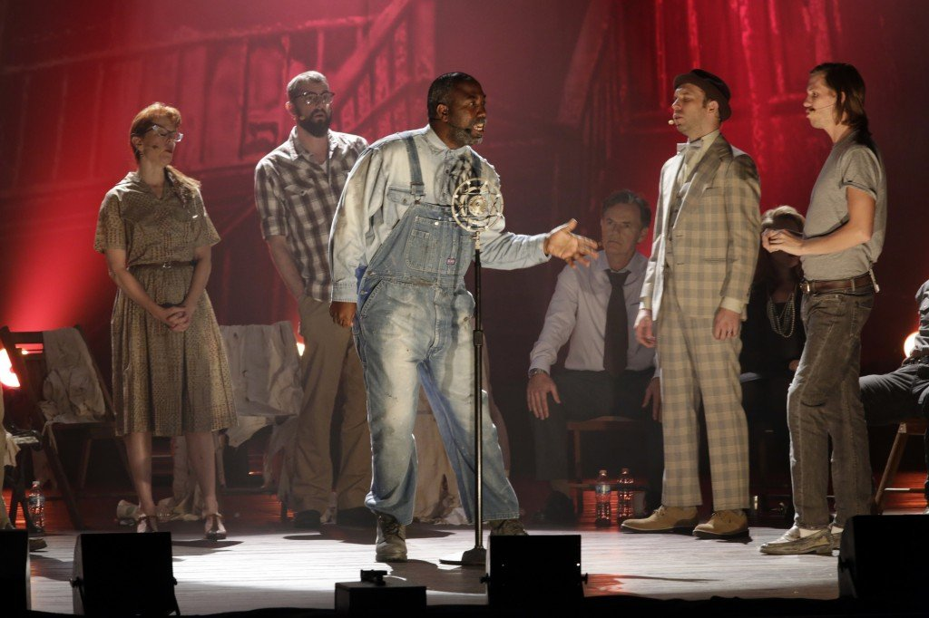 "Eric Moore, as Dan Coker, center, rehearses the musical ""Ghost Brothers of Darkland County"" at the Indiana University Auditorium in Bloomington, Ind., this month. The musical by John Mellencamp, writer Stephen King and T Bone Burnett will debut in Bloomington on Thursday before embarking on a tour of 20 U.S. cities."