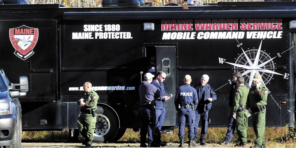 Officers from various agencies confer outside the Maine Warden Service Mobile Command Vehicle parked on Nike Lane in Oakland as officers searched the woods for signs of missing toddler Ayla Reynolds on Wednesday morning.
